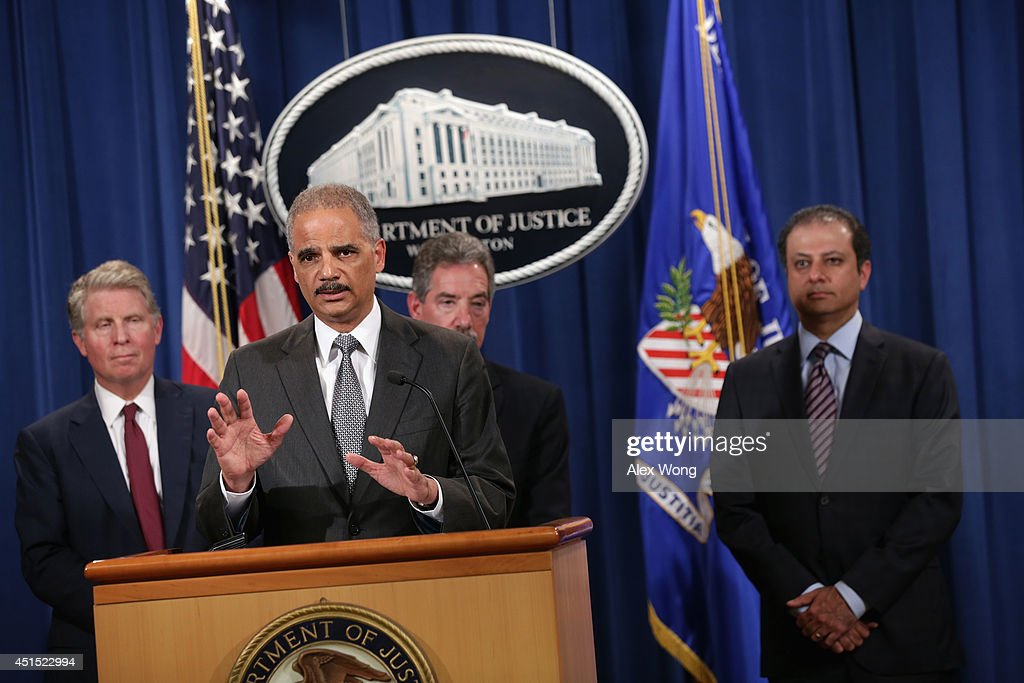 S Attorney General Eric Holder speaks as Deputy Attorney General James Cole US Attorney General for the Southern District of New York Preet Bharara...