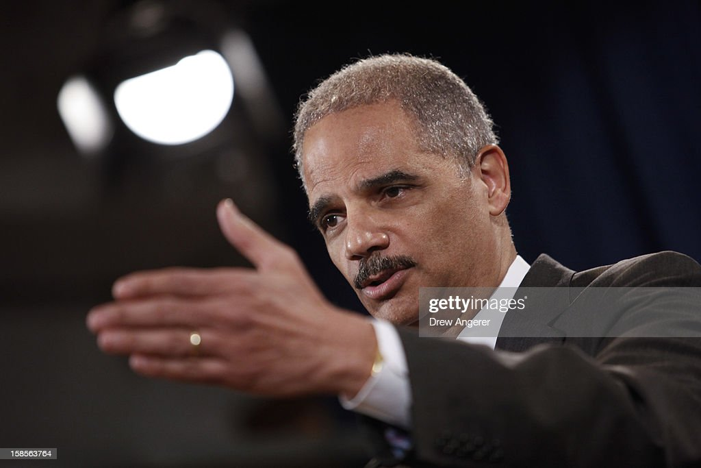 U.S. Attorney General Eric Holder speaks during a news conference at the Justice Department, on December 19, 2012 in Washington, DC. Holder announced investment bank UBS will pay 1.5 billion dollar fine to three on charges that the bank manipulated the libor interest rate.