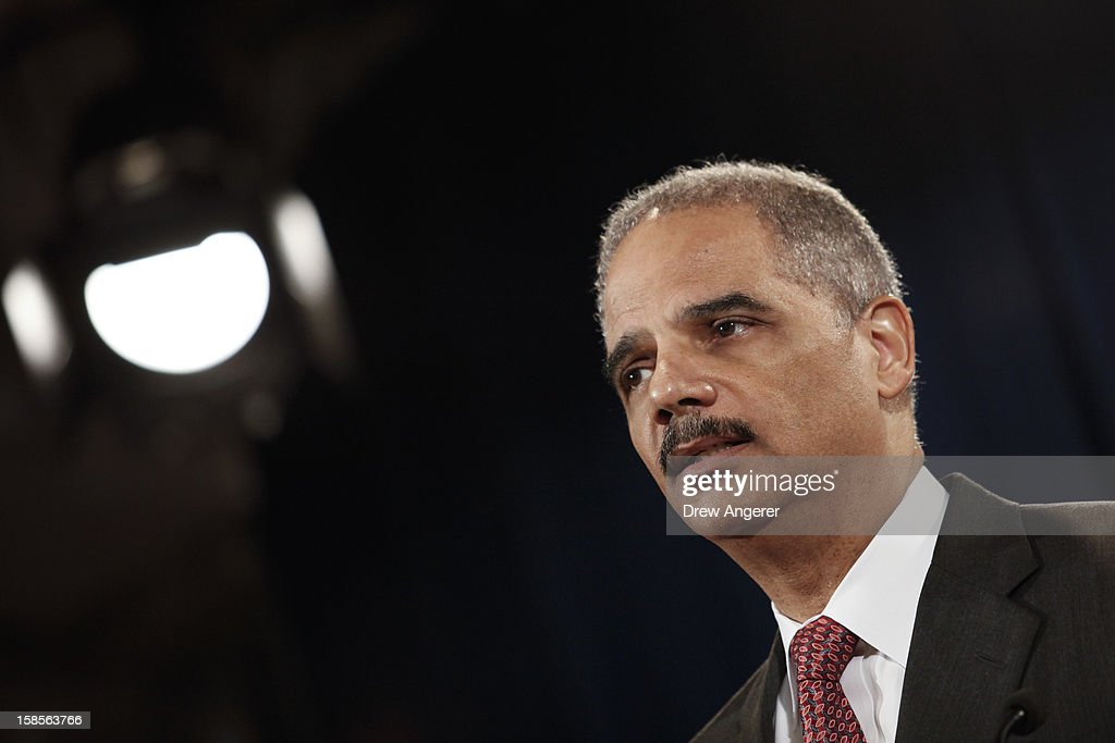 U.S. Attorney General <a gi-track='captionPersonalityLinkClicked' href=/galleries/search?phrase=Eric+Holder&family=editorial&specificpeople=1060367 ng-click='$event.stopPropagation()'>Eric Holder</a> speaks during a news conference at the Justice Department, on December 19, 2012 in Washington, DC. Holder announced investment bank UBS will pay 1.5 billion dollar fine to three on charges that the bank manipulated the libor interest rate.