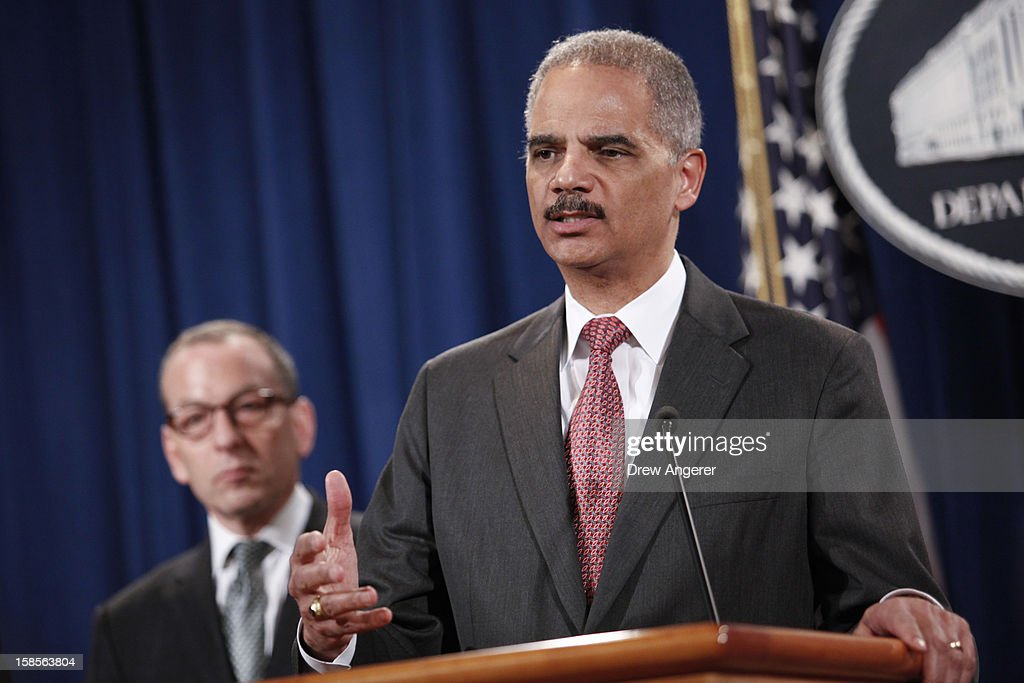 U.S. Attorney General <a gi-track='captionPersonalityLinkClicked' href=/galleries/search?phrase=Eric+Holder&family=editorial&specificpeople=1060367 ng-click='$event.stopPropagation()'>Eric Holder</a> (R) speaks during a news conference at the Justice Department as Assistant Attorney General of the Criminal Division Lanny A. Breuer listens on December 19, 2012 in Washington, DC. Holder announced investment bank UBS will pay 1.5 billion dollar fine to three on charges that the bank manipulated the libor interest rate.