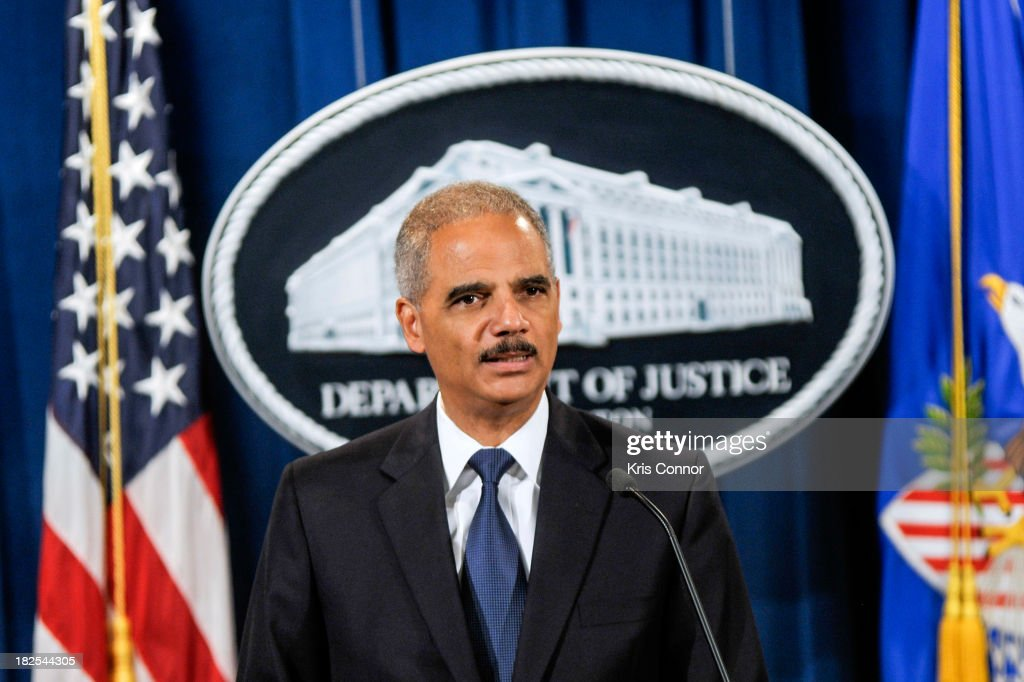 U.S. Attorney General <a gi-track='captionPersonalityLinkClicked' href=/galleries/search?phrase=Eric+Holder&family=editorial&specificpeople=1060367 ng-click='$event.stopPropagation()'>Eric Holder</a> speaks during a press conference announcing Department of Justice plans to sue North Carolina over Voter ID regulations at the Department of Justice on September 30, 2013 in Washington, DC. Under the new law North Carolina residents are required to show a photo ID at polling places which some believe threatens the voting rights of minorities.