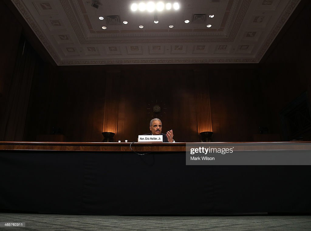 Attorney General <a gi-track='captionPersonalityLinkClicked' href=/galleries/search?phrase=Eric+Holder&family=editorial&specificpeople=1060367 ng-click='$event.stopPropagation()'>Eric Holder</a> testifies during a Senate Judiciary Committee hearing on Capotil Hill, on January 29, 2014 in Washington, DC. The committee is hearing testimony on oversight of the Justice Department and reform of government surveillance programs.