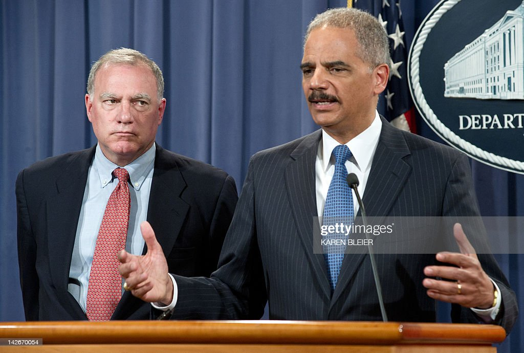 US Attorney General Eric Holder with Connecticut Attorney General George Jepsen announces a significant antitrust settlement on April 11 2012 during...