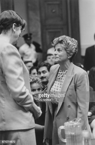 Attorney General Janet Reno talks with Rep Ileana RosLehtinen RFla and daughter Patricia in center on Aug 3 1995