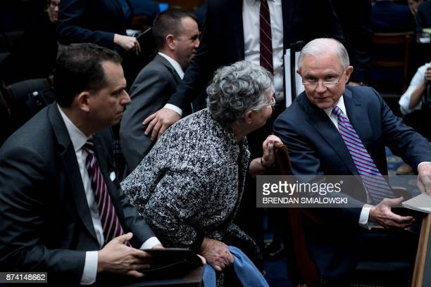 US Attorney General Jeff Sessions and his wife Mary Blackshear Sessions talk during a break in a hearing of the House Judiciary Committee on Capitol...