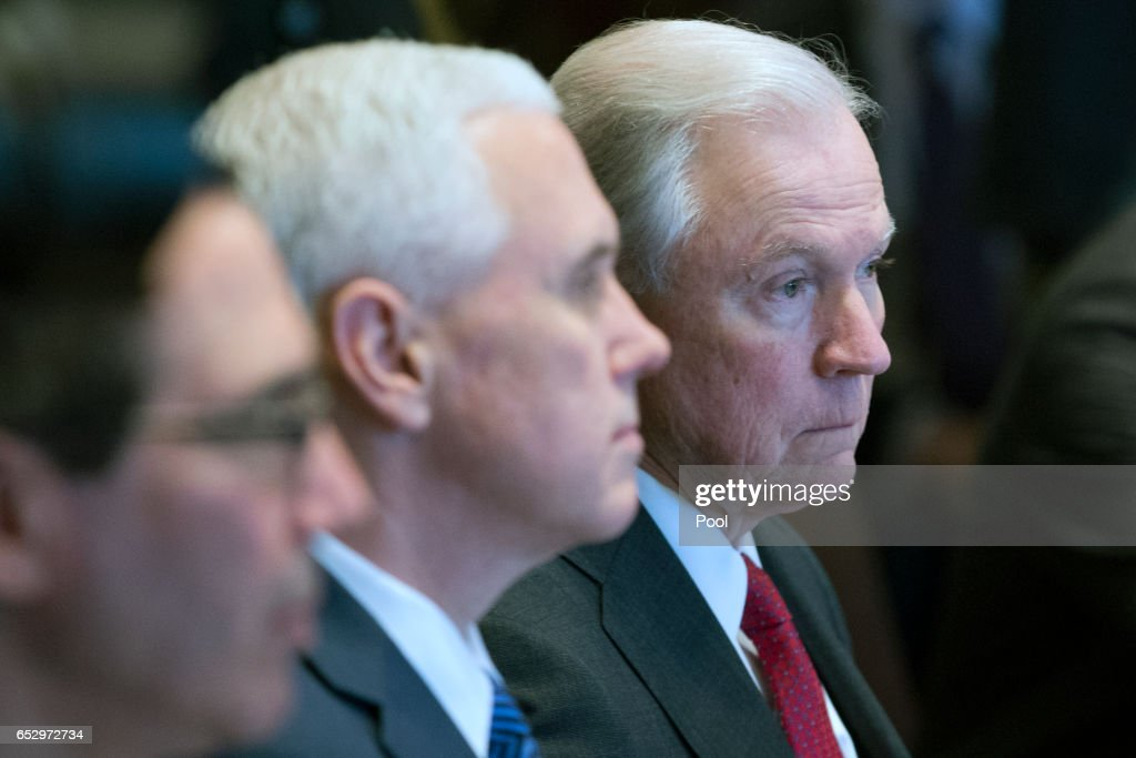 Attorney General Jeff Sessions (R) and Vice President Mike Pence attend a cabinet meeting with President Donald Trump (not pictured) in the Cabinet Room of the White House on March 13, 2017 in Washington, DC. This was the first official meeting of Trump's cabinet.
