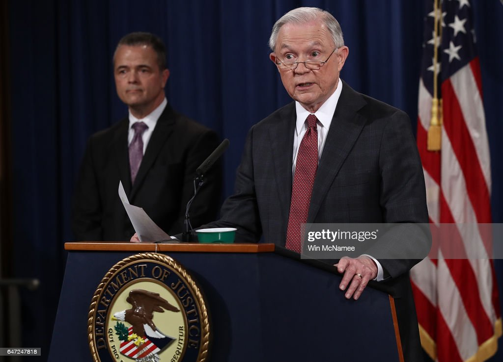 U.S. Attorney General Jeff Sessions (R) answers questions during a press conference at the Department of Justice on March 2, 2017 in Washington, DC. Sessions addressed the calls for him to recuse himself from Russia investigations after reports surfaced of meetings he had with the Russian ambassador during the U.S. presidential campaign. Also pictured is Sessions' Chief of Staff Jody Hunt (L).