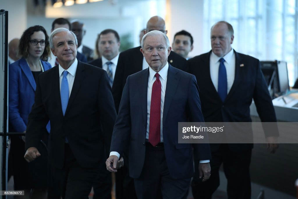 U.S. Attorney General Jeff Sessions arrives with Miami-Dade Mayor Carlos Gimenez (2nd L) for a speech at PortMiami on what he said is a growing trend of violent crime in sanctuary cities on August 16, 2017 in Miami, Florida. The speech highlighted jurisdictions like Miami-Dade that Mr. Sessions told the audience have increased their cooperation and information sharing with federal immigration authorities and have demonstrated a fundamental commitment to the rule of law and lowering violent crime.