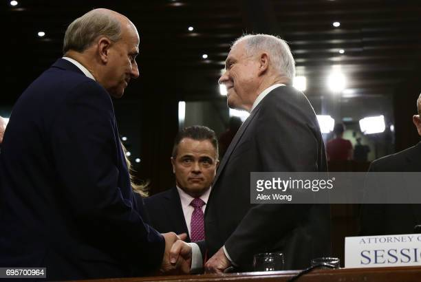 Attorney General Jeff Sessions greets Rep Louie Gohmert after a hearing before the Senate Intelligence Committee on June 13 2017 in Washington DC The...