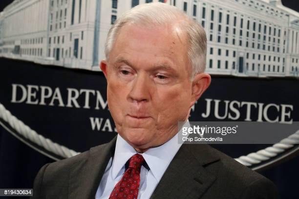 S Attorney General Jeff Sessions holds a news conference to announce an 'international cybercrime enforcement action' at the Department of Justice...
