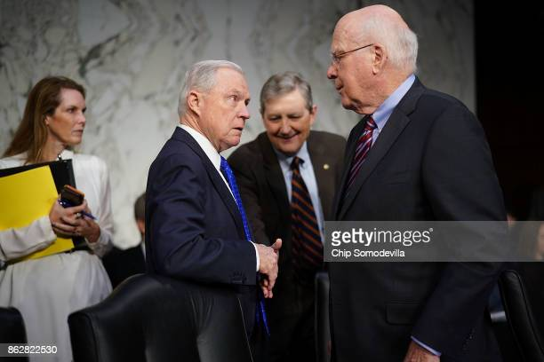 S Attorney General Jeff Sessions is greeted by Senate Judiciary Committee member Sen Patrick Leahy and Sen John Kennedy before a hearing in the Hart...