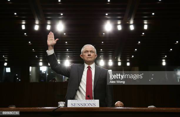 S Attorney General Jeff Sessions is swornin prior to testifying before the Senate Intelligence Committee on Capitol Hill June 13 2017 in Washington...