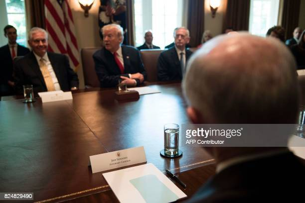 Attorney General Jeff Sessions listens as US President Donald Trump speaks during a cabinet meeting at the White House in Washington DC on July 31...