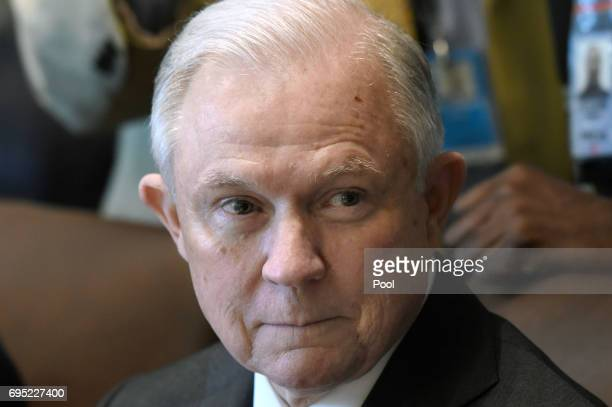 US Attorney General Jeff Sessions looks on during a meeting with US President Donald Trump in the Cabinet Room of the White House June 12 2017 in...