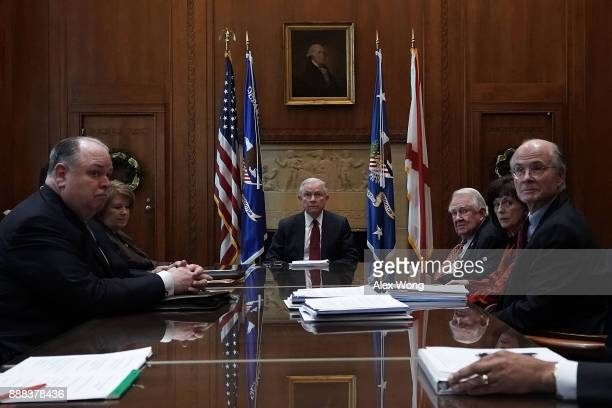 S Attorney General Jeff Sessions participates in a roundtable discussion December 8 2017 at the Justice Department in Washington DC Sessions hosted a...