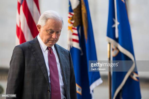 S Attorney General Jeff Sessions pauses for a moment of silence during a vigil ceremony marking the September 11 terrorist attacks at the Department...