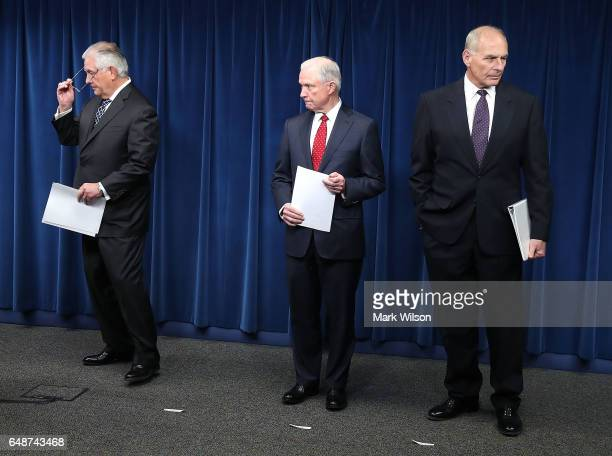 Attorney General Jeff Sessions Secretary of Homeland Security John Kelly and Secretary of State Rex Tillerson take part in a news conference about...