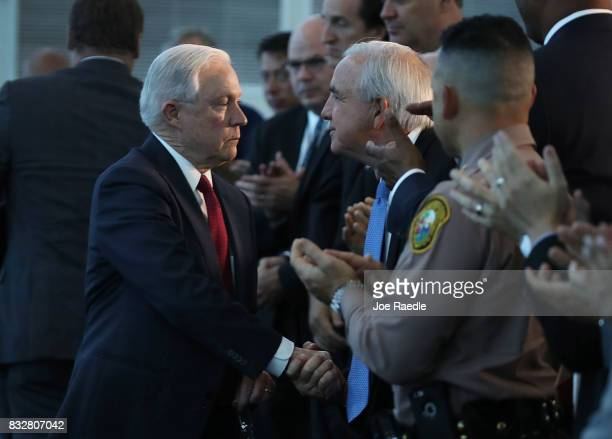 S Attorney General Jeff Sessions shakes hands with MiamiDade Mayor Carlos Gimenez after giving a speech on what he sees is a growing trend of violent...