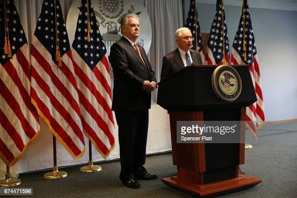 Attorney General Jeff Sessions stands with Long Island Congressman Peter King as he speaks to local state and federal law enforcement about a recent...