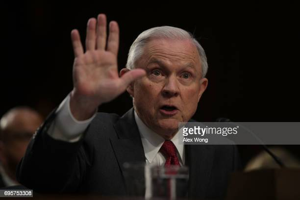 S Attorney General Jeff Sessions testifies before the Senate Intelligence Committee on Capitol Hill June 13 2017 in Washington DC Sessions recused...