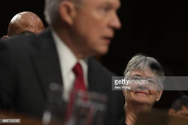Attorney General Jeff Sessions testifies during a hearing before the Senate Intelligence Committee as his wife Mary looks on June 13 2017 in...