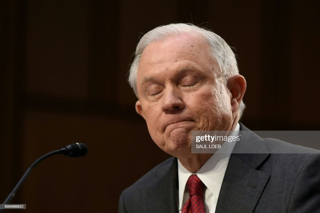 TOPSHOT - Attorney General Jeff Sessions testifies during a US Senate Select Committee on Intelligence hearing on Capitol Hill in Washington, DC, June 13, 2017. US Attorney General Jeff Sessions vehemently denied Tuesday that he colluded with an alleged Russian bid to tilt the 2016 presidential election in Donald Trump's favor. /