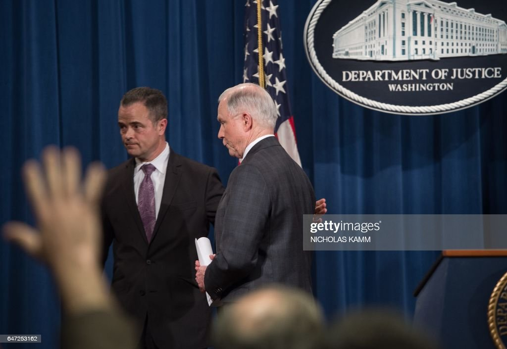 US Attorney General Jeff Sessions walks away with chief of staff Jody Hunt after holding a press conference at the Justice Department in Washington, DC, on March 2, 2017. Sessions announced Thursday that he would recuse himself from any investigations into President Donald Trump's 2016 election campaign. But after receiving a strong endorsement from Trump, Sessions did not bow to pressure to step down over charges he lied to Congress about his contacts with the Russian ambassador before the election. KAMM