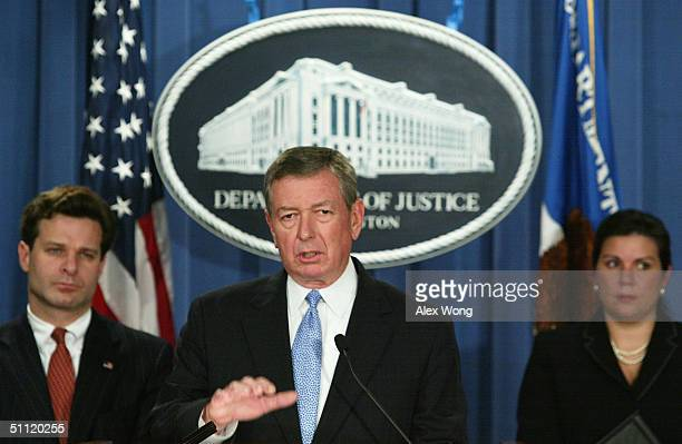 S Attorney General John Ashcroft speaks as Chief of Criminal Investigation of IRS Nancy Jardini and Assistant Attorney General for the Criminal...
