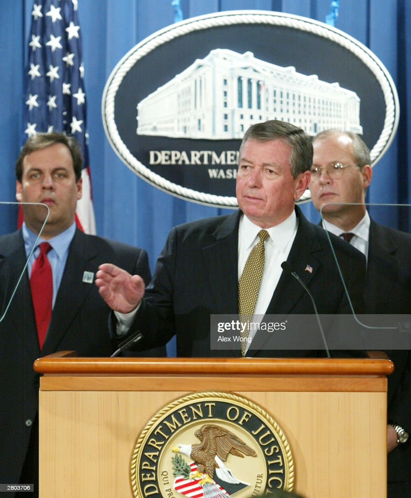 U.S. Attorney General John Ashcroft (C) speaks as U.S. Attorneys Christopher J. Christie (L) of New Jersey, Acting Director Bradley Buckles (R) of the Bureau of Alcohol, Tobacco, Firearms and Explosives listen during a media conference at the Department of Justice December 11, 2003 in Washington, DC. Ashcroft announced that criminal charges have been filed against several individuals, including a federally licensed firearms dealer in Ohio as well as against members of a violent street gang in New Jersey, for their roles in an alleged conspiracy to illegally traffic guns across state lines.