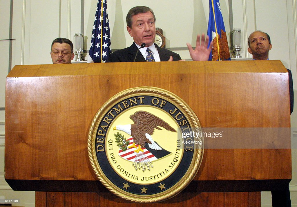 Attorney General John Ashcroft speaks during a press conference concerning the Metropolitan Police Department as Police Chief Charles Ramsey left and...