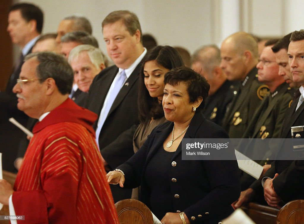 Attorney General Loretta Lynch (C) attends the 22nd annual 'Blue Mass' at St. Patrick's Catholic Church May 3, 2016 in Washington, DC. The mass is held by the National Law Enforcement Officers Memorial Fund to recognize the first responders who have given their lives in the past year.
