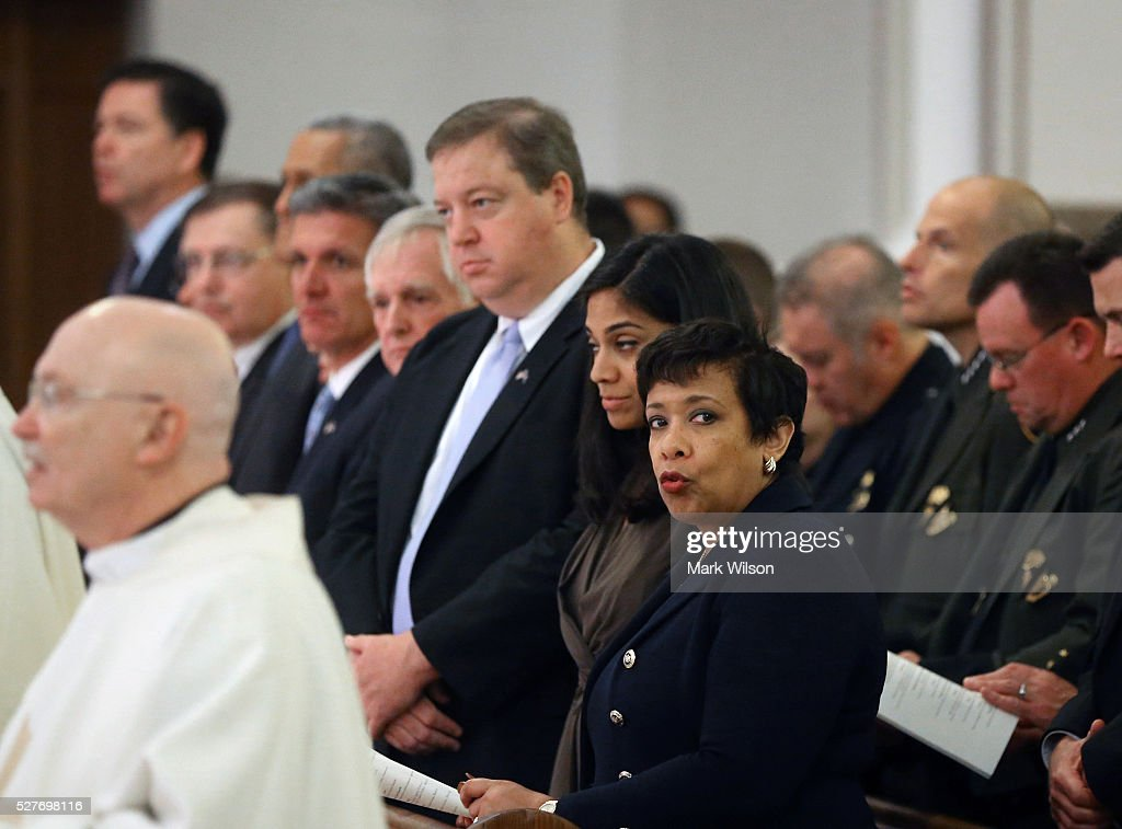 Attorney General Loretta Lynch (R) attends the 22nd annual 'Blue Mass' at St. Patrick's Catholic Church May 3, 2016 in Washington, DC. The mass is held by the National Law Enforcement Officers Memorial Fund to recognize the first responders who have given their lives in the past year.