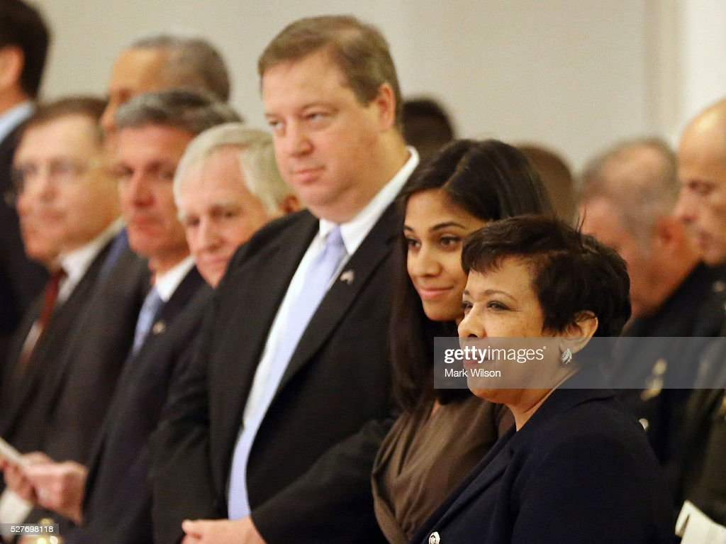 Attorney General <a gi-track='captionPersonalityLinkClicked' href=/galleries/search?phrase=Loretta+Lynch&family=editorial&specificpeople=4351972 ng-click='$event.stopPropagation()'>Loretta Lynch</a> (R) attends the 22nd annual 'Blue Mass' at St. Patrick's Catholic Church May 3, 2016 in Washington, DC. The mass is held by the National Law Enforcement Officers Memorial Fund to recognize the first responders who have given their lives in the past year.
