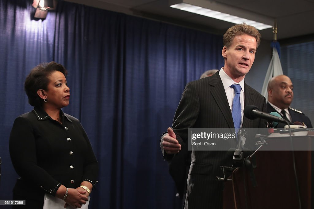 U.S. Attorney General Loretta Lynch (L) listens as Zachary Fardon, U. S. Attorney for the Northern District of Illinois, speaks at a press conference on January 13, 2017 in Chicago, Illinois. Lynch called the press conference to announce the release of a report which cited widespread abuses by officers in the Chicago police department following a 13-month investigation.