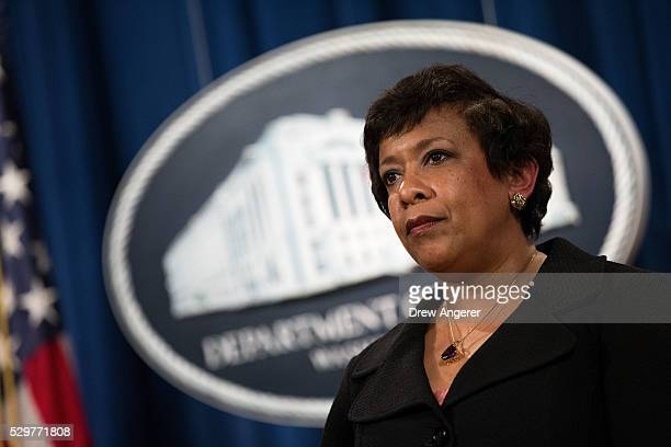 S Attorney General Loretta Lynch looks on after announcing federal action related to North Carolina at the US Department of Justice May 9 in...