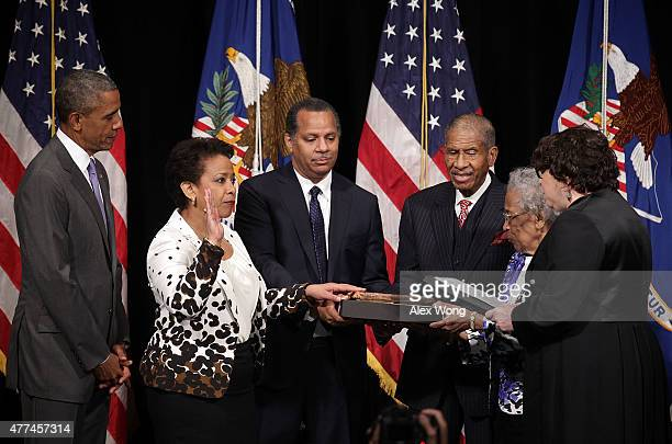 S Attorney General Loretta Lynch participates in a formal investiture ceremony administered by Supreme Court Justice Sonia Sotomayor as her husband...