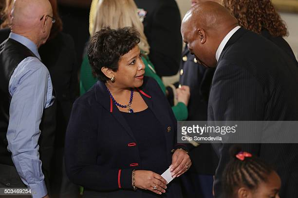 S Attorney General Loretta Lynch talks with victims of gun violence their families and supporters after before President Barack Obama delivers...