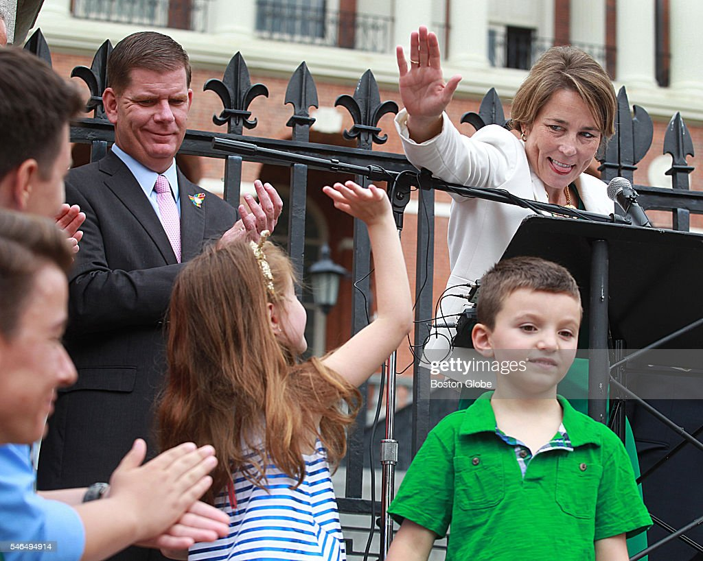 Attorney General Maura Healey gives a high five to Ella Lemay whose brother Jacob is transgender on the steps of the Massachusetts State House July...