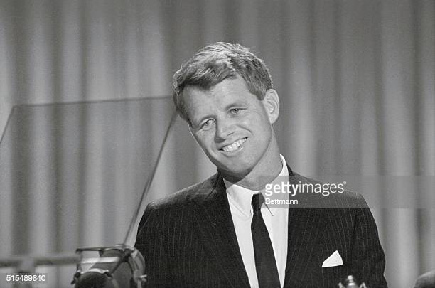 Attorney General Robert Kennedy smiling but with tears in his eyes receives the tremendous ovation of the Democratic National Convention