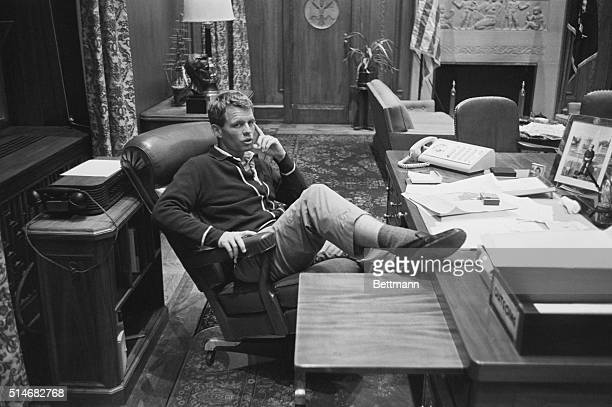Attorney General Robert Kennedy speaks with reporters in his office He is discussing the situation in Alabama where the governor declared martial law...