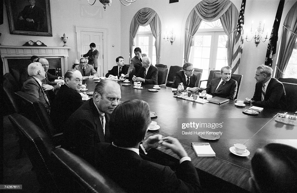 Attorney General William B Saxbe speaks with US President Richard M Nixon before Nixon's final cabinet meeting prior to resigning from the presidency...