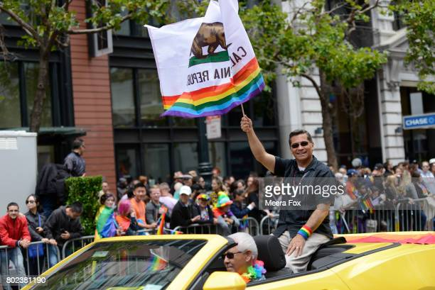 Attorney General Xavier Becerra rides in the San Francisco Gay Pride parade on June 25 2017 in San Francisco California