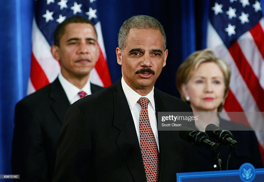 Attorney general-select <a gi-track='captionPersonalityLinkClicked' href=/galleries/search?phrase=Eric+Holder&family=editorial&specificpeople=1060367 ng-click='$event.stopPropagation()'>Eric Holder</a> (C) speaks as President-elect <a gi-track='captionPersonalityLinkClicked' href=/galleries/search?phrase=Barack+Obama&family=editorial&specificpeople=203260 ng-click='$event.stopPropagation()'>Barack Obama</a> (L) and Senator <a gi-track='captionPersonalityLinkClicked' href=/galleries/search?phrase=Hillary+Clinton&family=editorial&specificpeople=76480 ng-click='$event.stopPropagation()'>Hillary Clinton</a> (D-NY (R) listen at a press conference at the Hilton Hotel December 01, 2008 in Chicago, Illinois. Other members of the National Security Team named by Obama at the press conference include Arizona Governor Janet Napolitano as his choice for homeland security and he said Robert Gates would remain as defense secretary. Retired Marine Gen. James L. Jones was selected for the position of national security adviser and Susan Rice as U.N. ambassador.