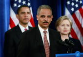 Attorney generalselect Eric Holder speaks as Presidentelect Barack Obama and Senator Hillary Clinton DNY listen at a press conference at the Hilton...