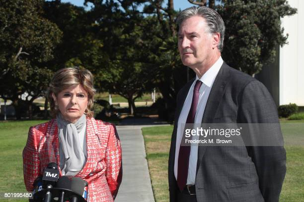Attorney Gloria Allred and attorney John West representing Judy Huth speak during a trial setting conference of a civil suit against Bill Cosby at...
