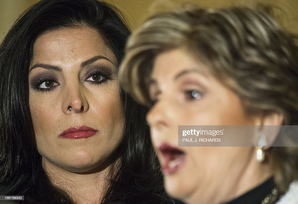 Attorney Gloria Allred and client Natalie Khawam(L) conduct a press conference November 20, 2012, at the Ritz-Carlton hotel in Washington, DC. Khawam is the twin sister of Tampa socialite Jill Kelley and wanted to correct misconceptions about her sister and her relationship with General David Petraeus and his wife Holly. AFP Photo/Paul J. Richards