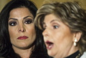 Attorney Gloria Allred and client Natalie Khawam conduct a press conference November 20 at the RitzCarlton hotel in Washington DC Khawam is the twin...