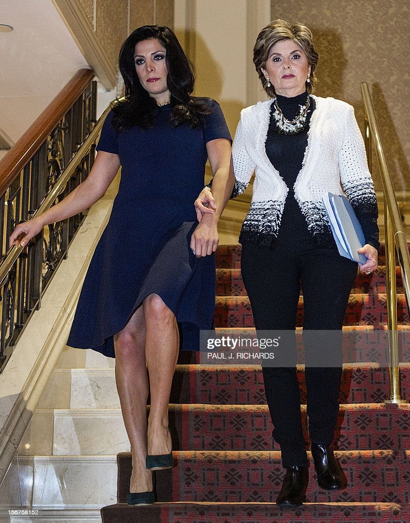 Attorney Gloria Allred and client Natalie Khawam(L), walk together to conduct a press conference November 20, 2012, at the Ritz-Carlton hotel in Washington, DC. Khawam is the twin sister of Tampa socialite Jill Kelley and wanted to correct misconceptions about her sister and her relationship with General David Petraeus and his wife Holly. AFP Photo/Paul J. Richards