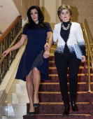 Attorney Gloria Allred and client Natalie Khawam walk together to conduct a press conference November 20 at the RitzCarlton hotel in Washington DC...