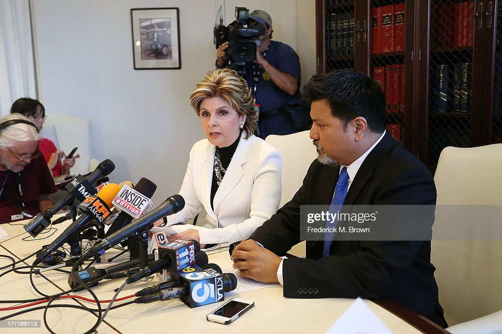 Attorney Gloria Allred (L) and Daniel Ramos speak during a news conference announcing a lawsuit against Kanye West after an attack at LAX Airport on August 21, 2013 in Los Angeles, California.